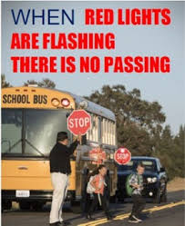 When red lights flash on a bus, there is no passing